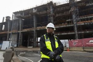 Goodwill's Lloyd Foster In Front Of Construction Site